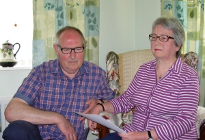Picture of Duncan and Pamela Boxford-White, holding the apology letter from Wiltshire Police in this unlawful arrest claim for an alleged Breach of the Peace.